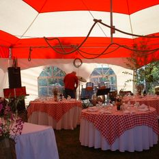 Inside red and white hex tent